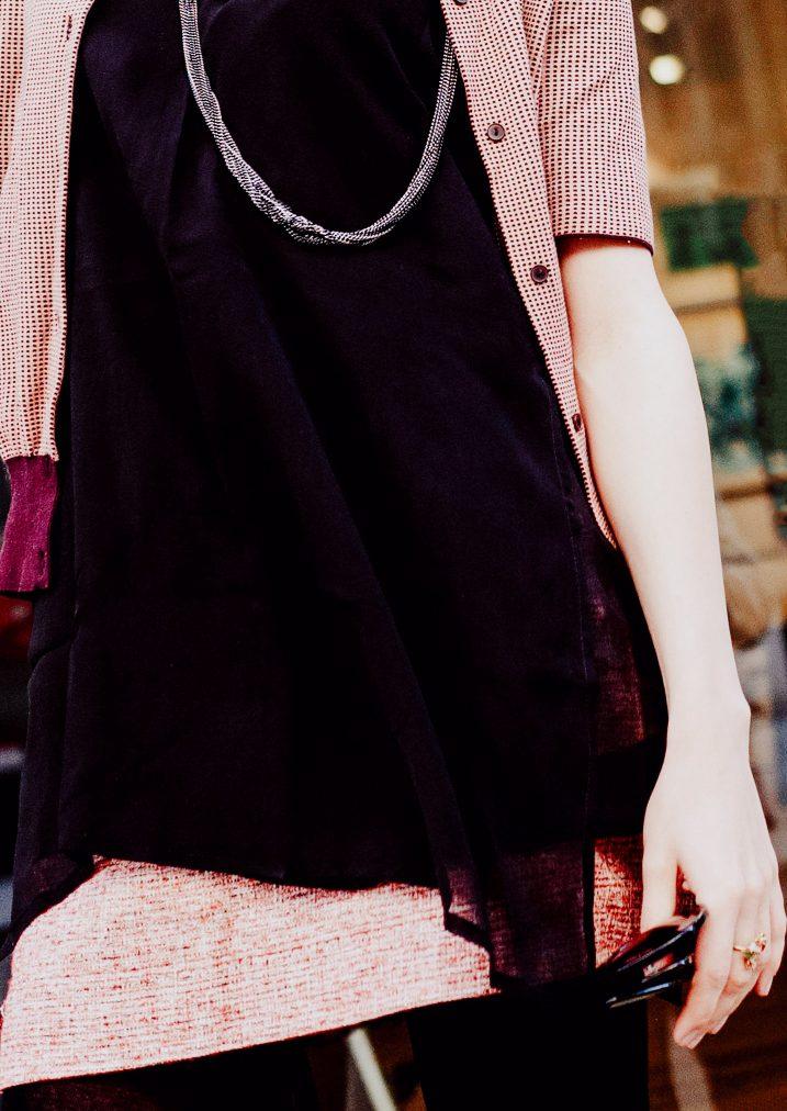black silk shirt, pink skirt, necklace