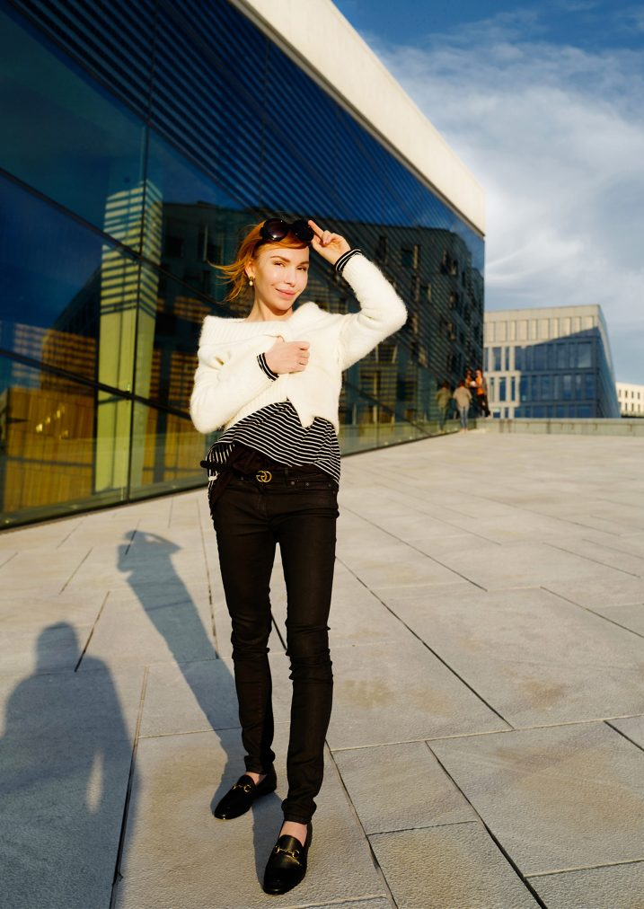 martha may wearing black and white outfit next to oslo opera