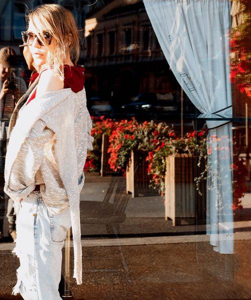 millennial woman fashion model posing next to ivar halvorsen bakery