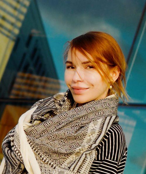 martha may fashion model wearing monochromatic shawl