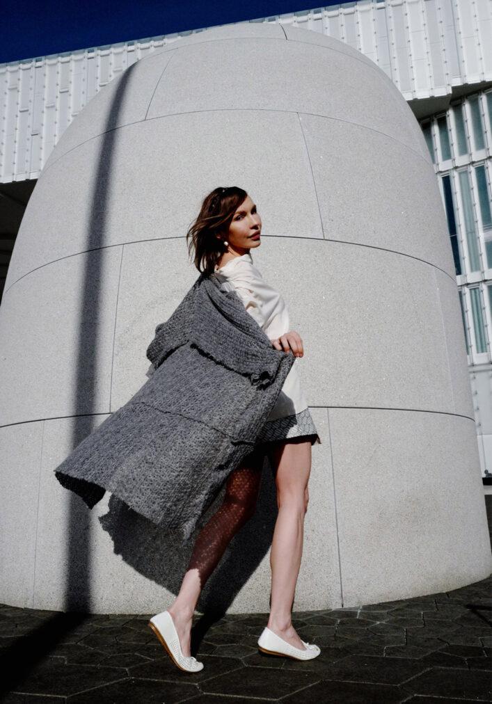 martha may wearing grey long sweater
