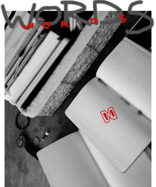 moleskine notebooks on table