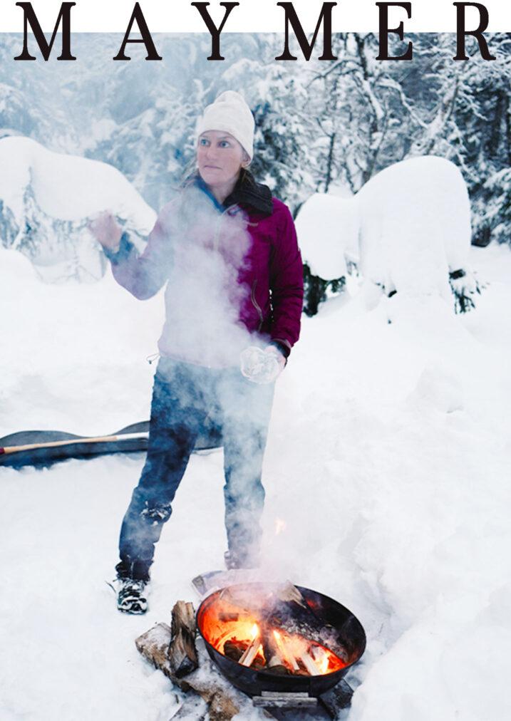 hytteliv girl starting a fireplace near hytta in oslo
