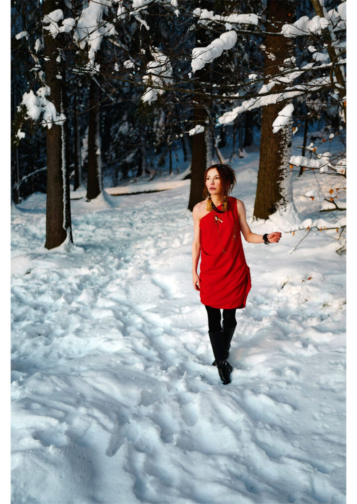 martha may walking through the winter forest in a red dress oslo norway