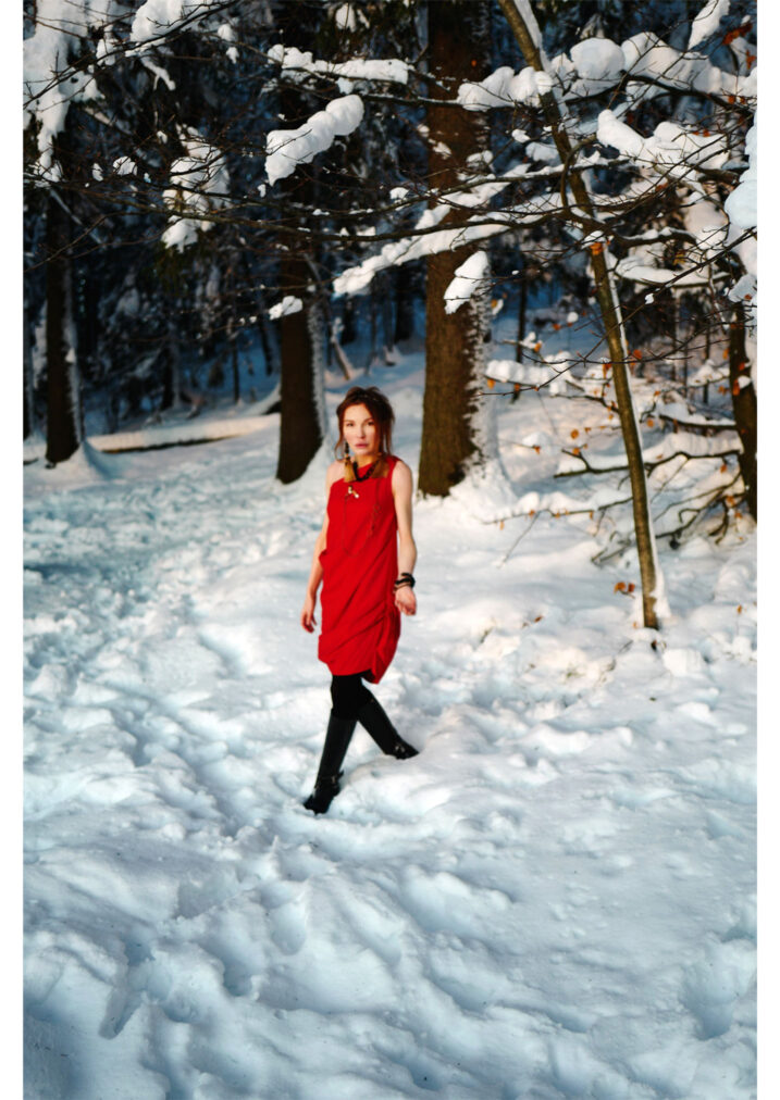 martha may red cocktail dress in winter forest norway
