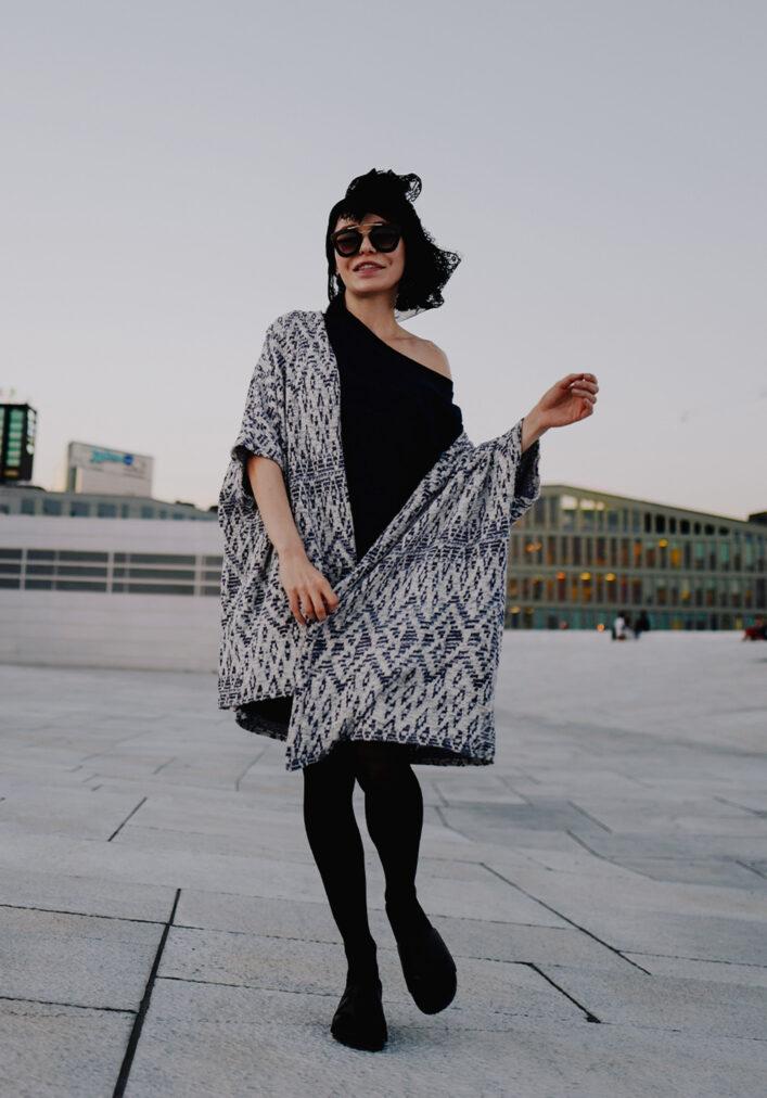 martha may walking in blue sweater at oslo opera norway