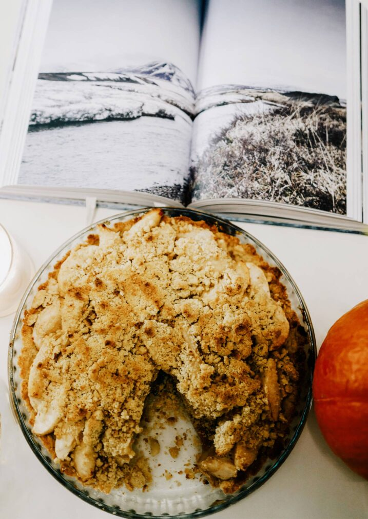 apple pie crumble next to a book and pumpkin