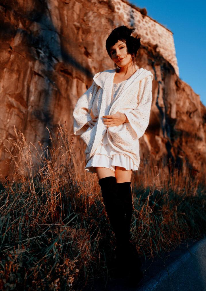 martha may wearing white sweater